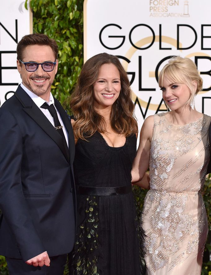 Robert Downey Jr., Susan Downey y Anna Faris